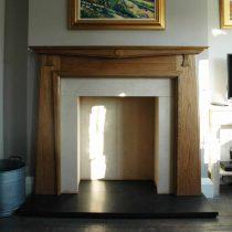 wooden fire surround|Pinckney Green