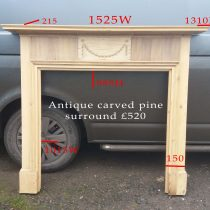 Antique carved pine surround